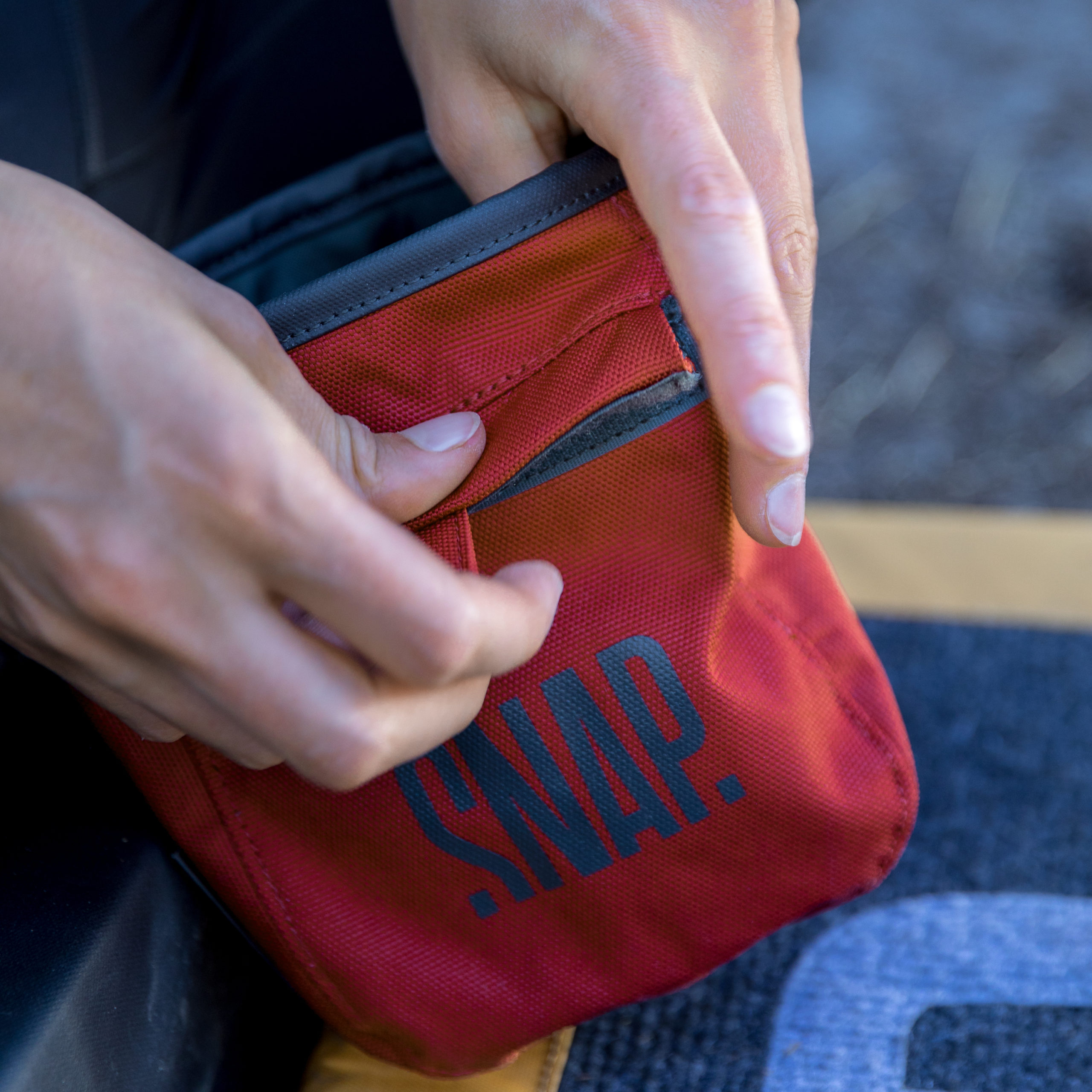 red chalk bag for rock climbing or bouldering detail