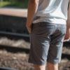 grey chino shorts man back