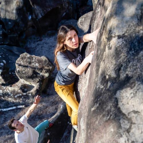woman climbing with a chino pants