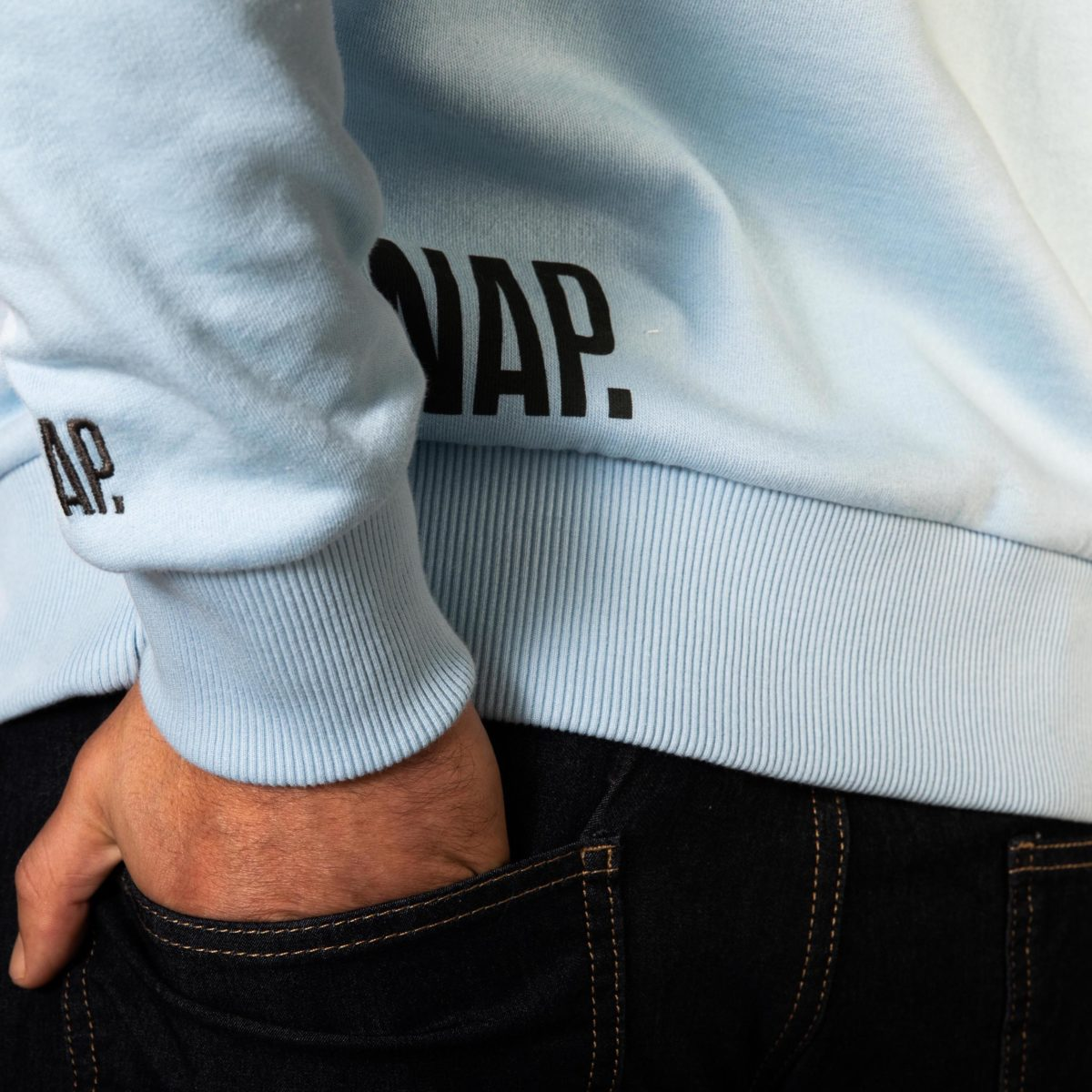 light blue sweater detail on snap climbing logo
