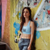 blue classic bra in front of a street art painting