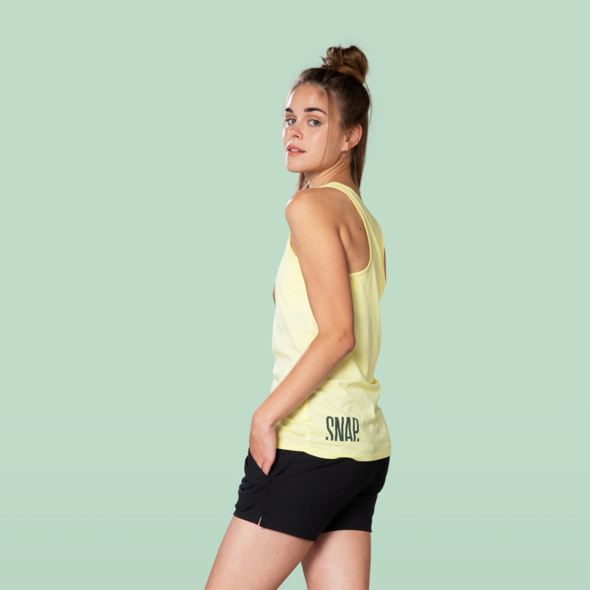 yellow fit tank top side and black sportswear shorts