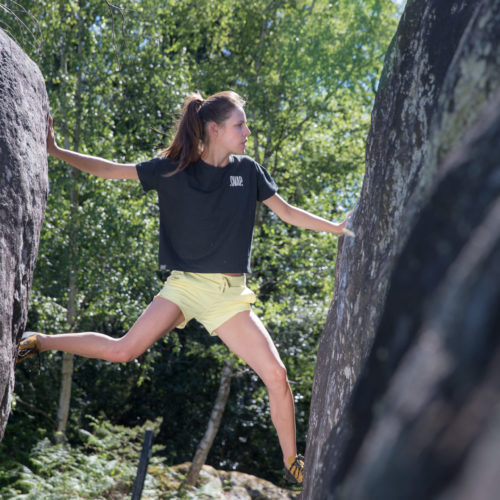 woman climbing with a black crop top