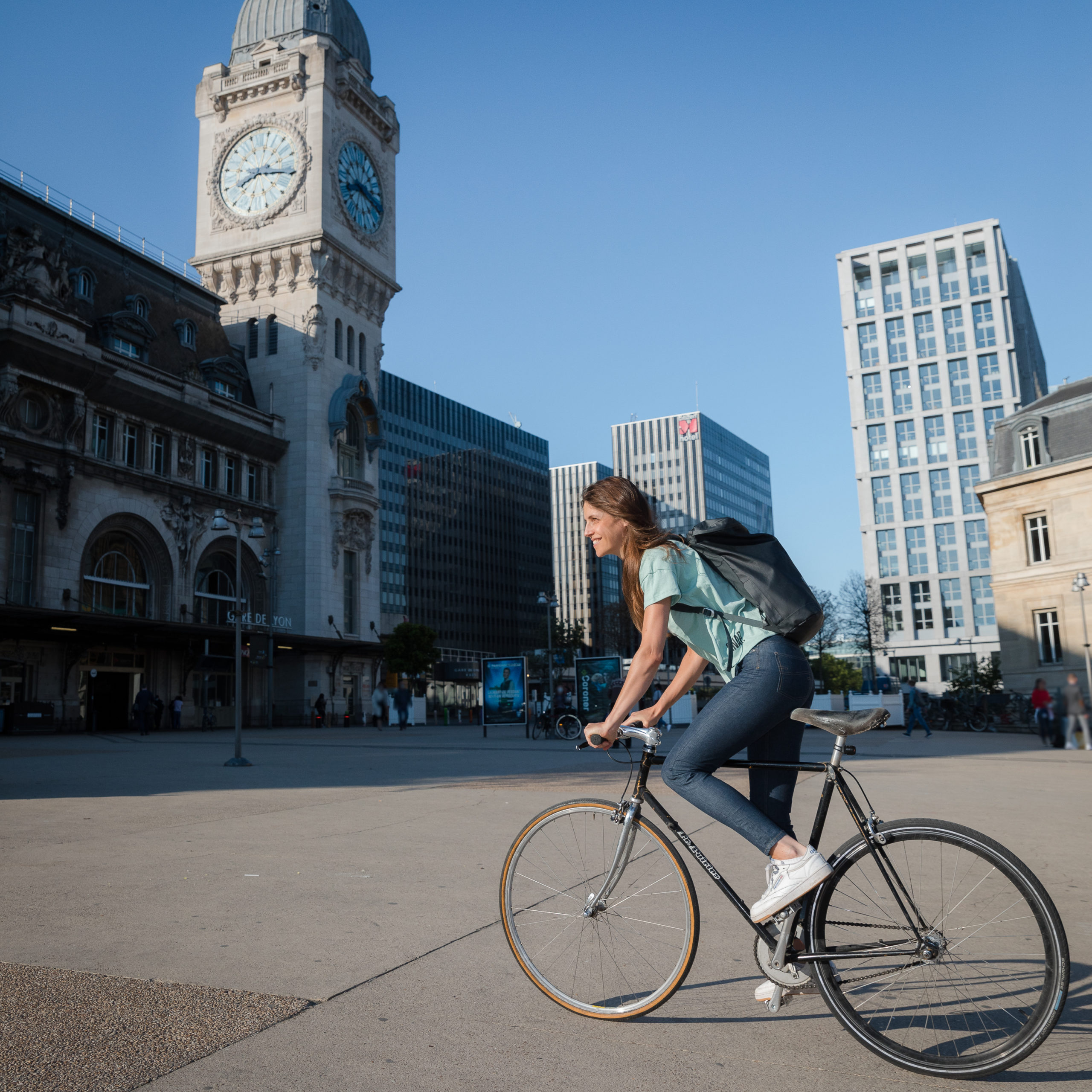 slim fit jeans on a woman riding a bike